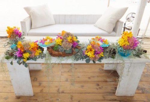 ラン(モカラ、デンファレ、パンダ)を使ったメインテーブル装花